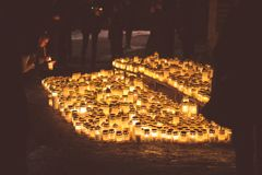 People lighting candles in the Kalevankangas cemetery in Tampere Royalty Free Stock Photo