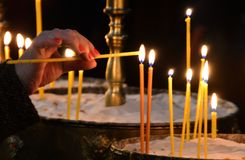 People Lighting Candles for a Religious Feast in a Church in Sofia, Bulgaria January 2018 Royalty Free Stock Photo