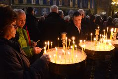 People Lighting Candles for a Religious Feast in a Church in Sofia, Bulgaria January 2018 Royalty Free Stock Image