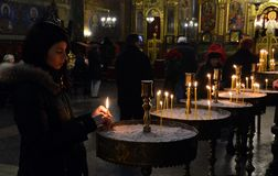 People Lighting Candles for a Religious Feast in a Church in Sofia, Bulgaria January 2018 Stock Photo