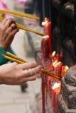 People lighting incense sticks (1). People  lighting incense sticks to commemorate ancestors (1 Stock Images