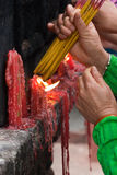 People lighting incense sticks (2) Stock Photos