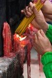 People lighting incense sticks (2). People  lighting incense sticks to commemorate ancestors (2 Stock Photos