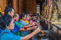 People lighting incense Wat Yai Chaimongkol Ayutthaya bangkok th Stock Photo