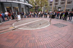 People in line around railway turntable for cable cars Royalty Free Stock Images