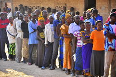 People  in line at at polling station. People queuing to vote at polling station , Zambia tripartite elections 2011 Stock Photos
