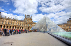 People at the line to Louvre museum in Paris. stock photos