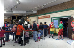 People on line to visit Santa inside Macy's in NYC Stock Photography