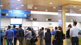 People line up for applying driver license at reception site stock video footage