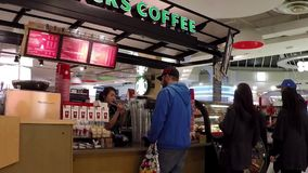 People line up for buying coffee at Starbucks stock footage