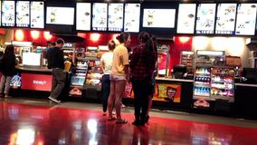 People line up for buying food at cinema stock video