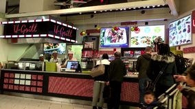 People line up for buying food at food court area stock video