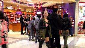People line up for buying ice cream during Christmas shopping season time stock video