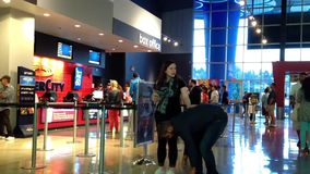 People line up for buying movie ticket at cinema stock video