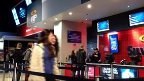 People line up for buying movie ticket at cineplex stock video