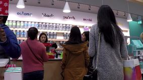 People line up for buying tea inside Burnaby shopping mall stock video