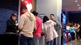 People line up for buying vip movie ticket at cinema stock video