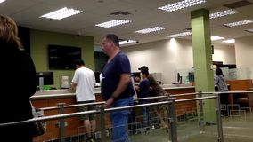 People line up for deposit money stock video footage