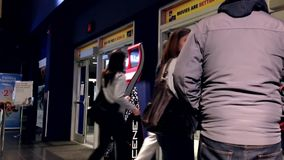 People line up for leaving the movie theater stock footage