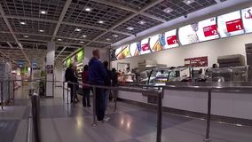 People line up for ordering meal at food court cafeteria. Royalty Free Stock Image