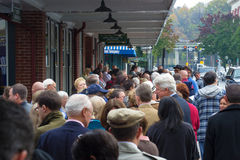 People Line Up for a Political Rally Stock Image
