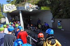 People line up to Skyline Rotorua Luge ride Royalty Free Stock Photo