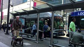People line up for waiting bus. At downtown Vancouver stock footage