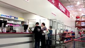 People line up for waiting to pick up their medicine. Inside Costco pharmacy stock footage