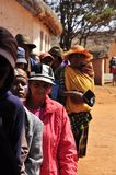 People in line  waiting at the entrance in the polling station Stock Image