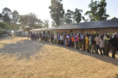People in line waiting to cast their vote. Elections in Africa royalty free stock photography