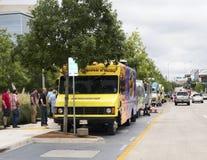 People lined up at food trucks at noon Royalty Free Stock Image