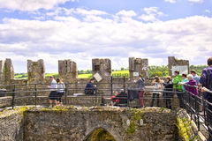 People lining up to kiss Blarney stone at Blarney castle Ireland Royalty Free Stock Photography