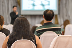 People listen in business seminar hall of hotel room. Selective focus Royalty Free Stock Image