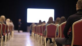 People listen to the presentation the conference hall. Back view. Business people seminar conference training concept. stock video footage
