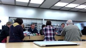 People listening the Apple worker introducing new app stock footage