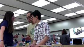 People listening the Apple worker introducing new ipad stock video footage