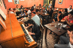 People listening at a music entertainment in a bar Stock Photography