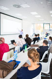 People listening to a presentation. In a modern, bright meeting room (shallow DOF; color toned image Stock Images