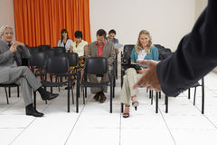 People Listening To Seminar In Conference Room Stock Image