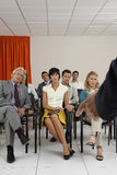 People Listening To Seminar In Conference Room Stock Photo