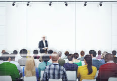 People Listening to the Speaker's Presentation Stock Image