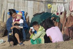 People of Lisu ethnic group sit in front of the house in Chiang Mai, Thailand. Stock Photos