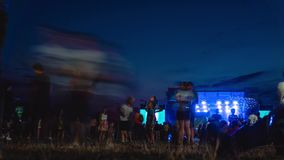 People on a live open air music show, concert, blur, time lapse. night summer time. light and fast motion.  stock video footage