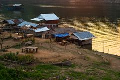 People living in houses floating in the water. Waterfront house. With sunlight in evening Ban Mon,Kanchanaburi,Thailand royalty free stock images