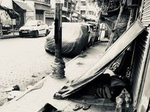 Street life's in Kolkata India. People living on the streets in a local town area in Kolkata, India isolated unique photograph stock image