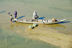 People load boat with vegetables in Bandarban, Bangladesh. Royalty Free Stock Photos