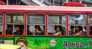 People on the local bus in Bangkok, Thailand stock photos
