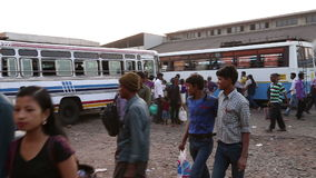People at local bus terminal in Goa. GOA, INDIA - 27 JANUARY 2015: People at local bus terminal in Goa stock video footage
