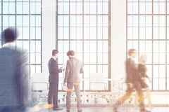 People in loft meeting room, toned. People are talking in a conference room before the meeting. Loft room with tall windows, white table and chairs. 3d rendering Royalty Free Stock Photography