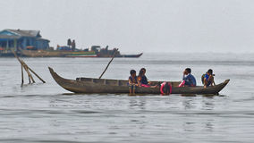 People in long boat, Tonle Sap, Cambodia Stock Images